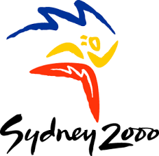 Logo from Sydney 2000 Games, cartoon image of athlete made out of a boomerang and 'Sydney 2000' appearing 'handwritten'