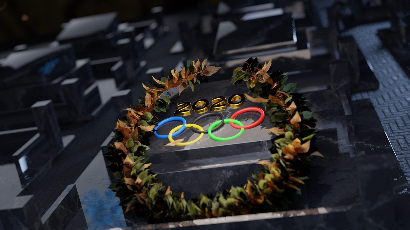 GV of Olympic Rings, 'Tokyo' and a laurel wreath of flames